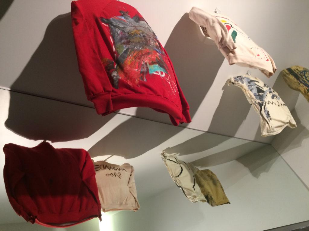 Mirrored display of sweatshirts painted by Jean-Michel Basquiat.