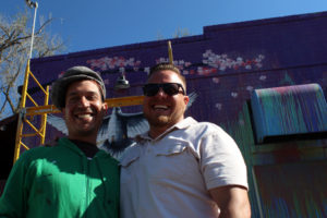 Luis Valle (left) with Lorenzo Talcott (right) in front of mural at Local 46 on Thursday, May 11, 2017.
